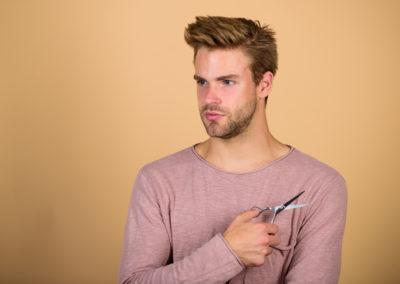 Male Barber Care. Handsome Man With Hairdresser Scissors. Barber